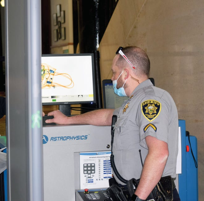 Master Deputy Russell Klepees of the Leavenworth County Sheriff's Office operates a security station located at the south entrance of the Leavenworth County Courthouse. New security measures were implemented Wednesday at the courthouse.