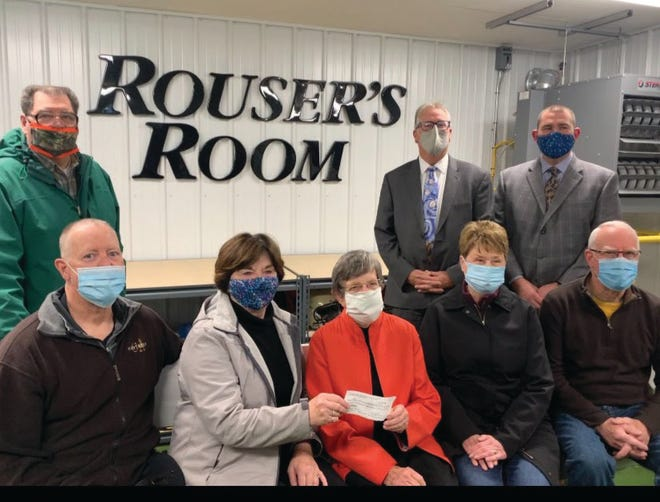 """Over $75,000 was donated by the many friends of Dan Rouse towards an addition to the MHS football field house in his honor.  """"Rouser"""" volunteered for 40 years as an equipment manager, statistician, and friend of Bomber athletes.  Pictured representing the """"Friends of Dan Rouse"""" are top row (L to R):   David Bormet, Dr. Patrick Twomey, Eric Jameson  Seated:  Max Kreps, Shelley Kreps, Barbara Hoyt (mother of Dan Rouse), Phoebe Bormet, Jerry Cremer"""