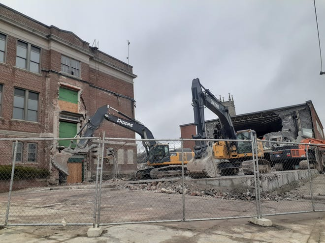 Excavators tear down a section of Milford's long-vacant Middle School East.