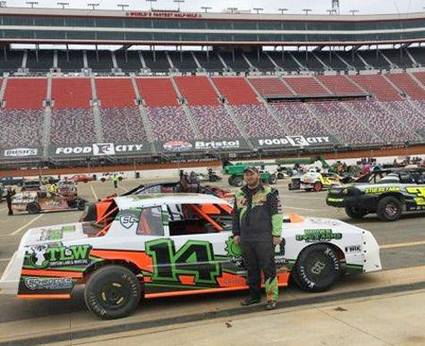 Derrick Agee, 29, Moberly, stands next to the Stock Car he drove on Bristol Motor Speedway in Connecticut during the 2021 Bristol Dirt Nationals held March 15-20.