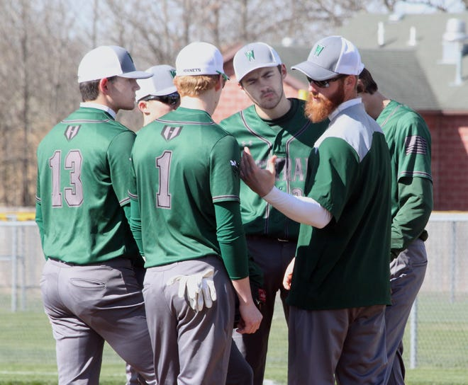 Westran High School baseball coach Tyler Tanner gestures with his hand as he is shown visiting with infielders of the Hornets 2019 spring team during a home game played that season. Tanner will be head coach at Westran for his first time this 2021 season.