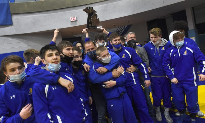 Jefferson's wrestling team celebrates after winning the Team Regional it hosted Wednesday.