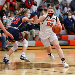 Summerfield's Abby Haller drives past Britton Deerfield's Jill Molnar in the finals of the Division 4 district at Britton on Wednesday night. Summerfield won 53-28.