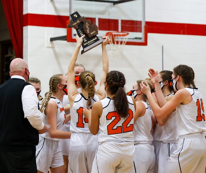 The Summerfield girls basketball team hoists the championship trophy after beating Britton Deerfield 53-28 in the finals of the Division 3 District at Britton Wednesday night.