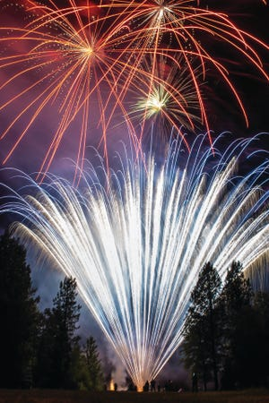 Pyrotechnic crews set off fireworks from the shore of Lake Siskiyou on the Fourth of July in 2019.