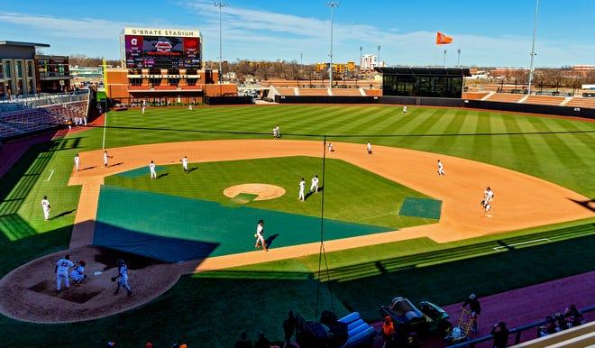 Oklahoma State's baseball team warms up before hosting Arkansas-Little Rock in the opener of O'Brate Stadium on Feb. 24, 2021. [Chris Landsberger/The Oklahoman]