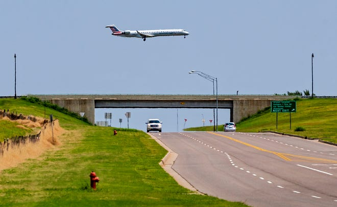 An American Eagle flight flies over SW 54 as it approaches for a landing at Will Rogers World Airport. Officials have announced that nonstop flights between Oklahoma City and New York City will be available soon.