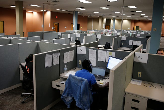 Call center workers sit their desks at the Oklahoma State Department of Health's former COVID-19 contact tracing center inside the old Shepherd Mall in 2020.