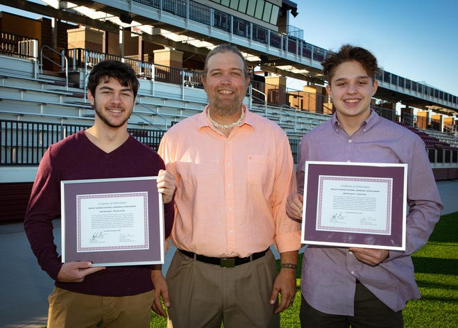 Pictured left to right are Mitchell Suttle; Luke Orvis, Edmond Memorial High School coach; and Robert Ray.