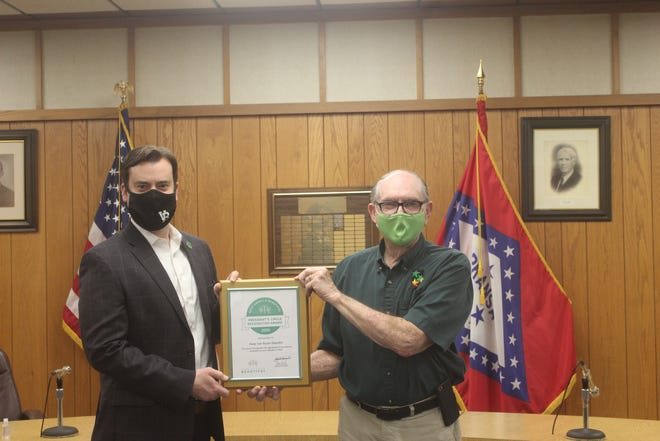 """Van Buren Mayor Joe Hurst congratulates John Pope and Keep Van Buren Beautiful recently after receiving the President's Circle recognition award from Keep American Beautiful. The award was presented to Pope for """"meeting and exceeding the requirements"""" set by the national and local organizations. Van Buren is among five other Arkansas affiliates who received this award."""
