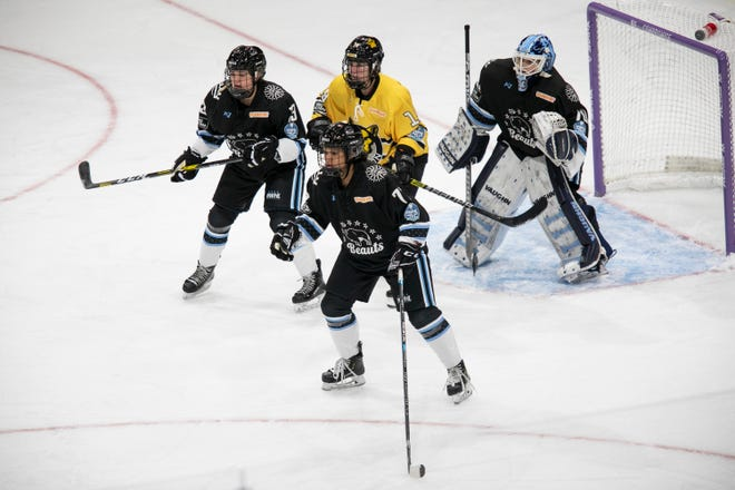 Buffalo Beauts defenders Dominique Kremer and Whitney Dove bracket Boston Pride forward Sammy Davis, of Pembroke, in front of goaltender Carly Jackson in a game in Lake Placid, N.Y., on Jan 24, 2021.