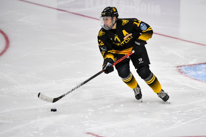 Boston Pride defenseman Kaleigh Fratkin brings the puck up ice during an NWHL game against the Minnesota Whitecaps at Herb Brooks Arena in Lake Placid, N.Y., on Jan. 23, 2021.