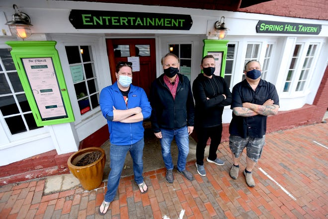 """The Striker owners, from left, Christopher MacDonald, Peter DiZoglio, Daniel Wright and Billy Rogan are reopening April 1 after """"hibernating"""" for the winter of COVID-19."""