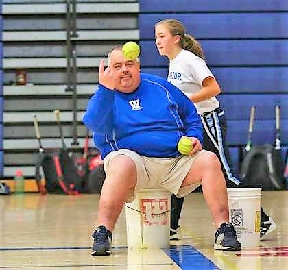 """Winnacunnet High School softball coach Dennis Bruce doesn't see how a randomly seeded, open tournament is fair. """"It doesn't make any sense tome,I just don't get it."""""""