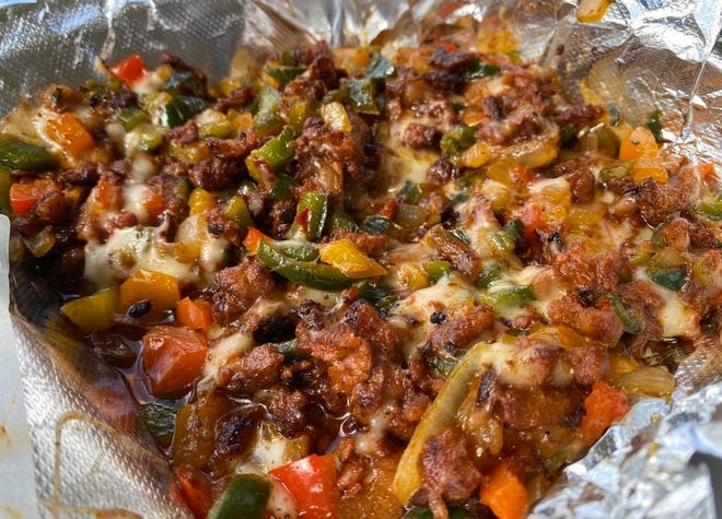 Alambre is among the authentic Mexican dishes served at Taqueria La Bendicion food truck in Perry Township. The specialty features a   choice of meat, bell peppers, poblano pepper, pineapple, onions, cheese and a side of tortillas.