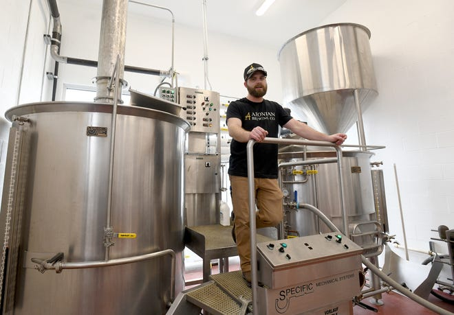 Aeonian Brewing Co. co-owner Brandon Benson shows off the 15-barrel brewing system in Alliance on Thursday.