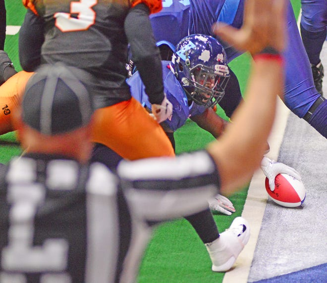 Salina Liberty running back Tracy Brooks stretches the ball across the goal line for a touchdown of the 2019 CIF Northern Division championship game against Omaha Beef at the Tony's Pizza Events Center. The Liberty will kick off the new season Saturday against the Arlington Cowboys.