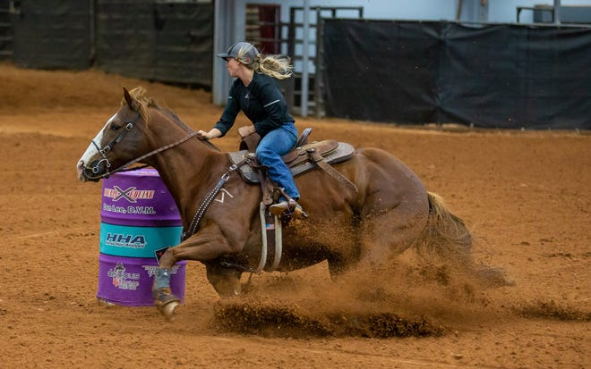 Stephenville's Emma Wildeisen and Stella record the time of 15.463 at the Jackpot at the Expo on Wednesday night in Glen Rose.