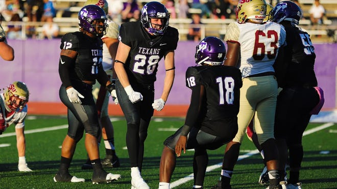 Tarleton players react to a play during last weekend's homecoming game against Midwestern State at Memorial Stadium. The Texans won, 33-21. The Texans will host Northeastern State (OK) at 6 p.m. Saturday.