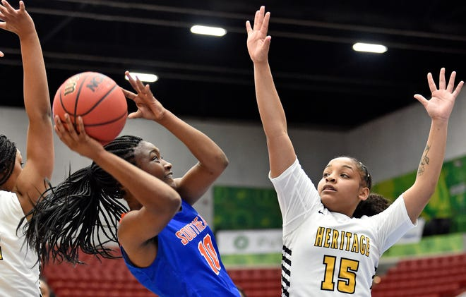 Southeast High's Perryauna Youmans, shooting at right, averaged 15 points and 5 assists per game for the Seminoles during the 2020-21 girls basketball season.