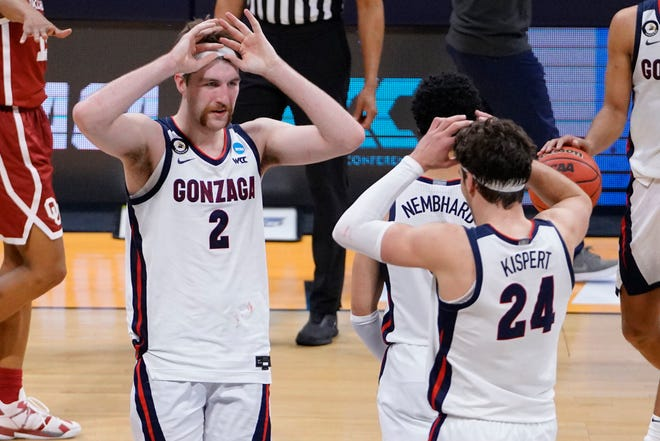 Gonzaga forward Drew Timme (2) celebrates with teammate Corey Kispert (24) after the Zags defeated Oklahoma in the second round of the NCAA men's college basketball tournament at Hinkle Fieldhouse in Indianapolis on Monday.