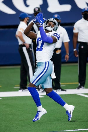 Dallas Cowboys wide receiver Malik Turner (17) reaches for a pass during warm-ups before a game against the Atlanta Falcons, Sunday, Sept. 20, 2020, in Arlington, Texas.