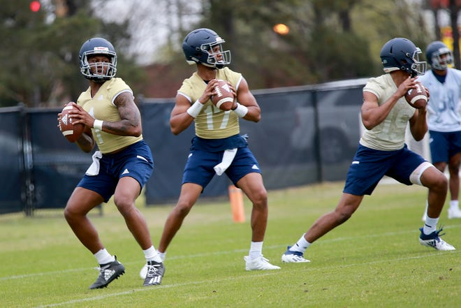 Georgia Southern quarterbacks James Graham (1) and Justin Tomlin (17) drop back to pass Wednesday during the first spring practice on Wednesday at the Eagle Creek fields in Statesboro.