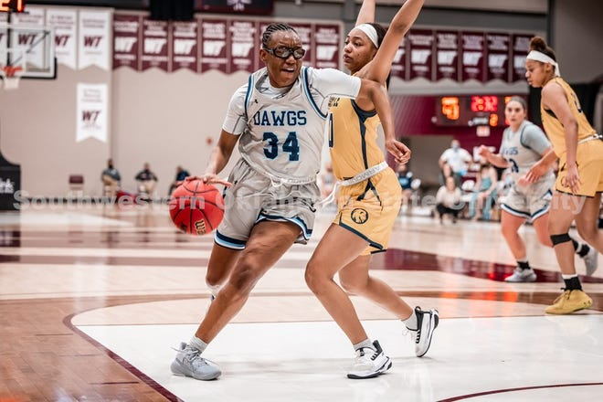 Former Shawnee High School standout Makyra Tramble (34) drives the basketball against Texas A&M-Commerce during the semifinals of the NCAA Division II South Central Regional on March 13 in Canyon, Texas.