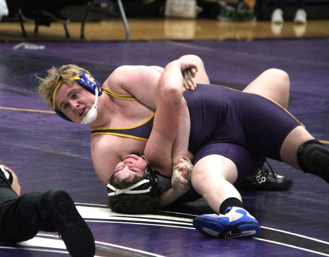 Blayn Gibson of Bronson works to pin Hunter Gillies in team regionals on Wednesday.