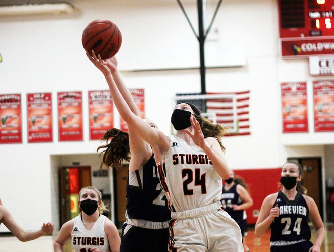Korin Whitcomb heads up for two points against Battle Creek Lakeview on Wednesday evening.