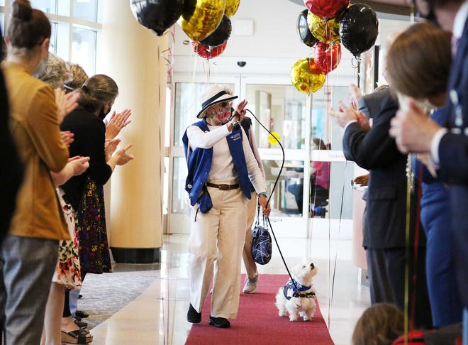 """CarolinaEast Medical Center celebrates the return of volunteers and therapy dogs with a festive red carpeted Volunteer """"Celebrity"""" Welcome Back event at CarolinaEast Medical Center in New Bern, NC, March, 25, 2021. The event welcomes volunteers after state mandates are revised concerning the COVID-19 pandemic. [Gray Whitley / Sun Journal Staff]"""