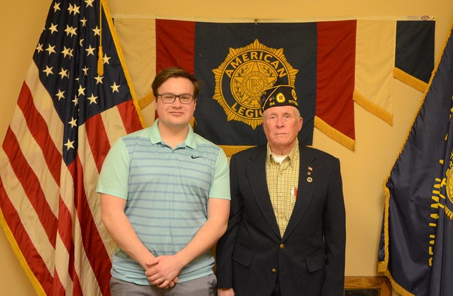 Owen Miller, a junior at Pittsburg High School and winner of the American Legion's statewide oratorical contest, left, with Allen Eichhorn, adjutant for the Pittsburg American Legion Post 64.