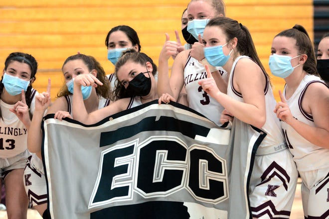 Killingly girls celebrate behind an ECC Championship banner Wednesday after beating Windham 41-29 in the ECC North Final in Killingly.