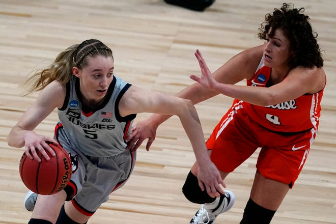 UConn guard Paige Bueckers (5) drives under pressure from Syracuse guard Tiana Mangakahia (4) during the Huskies' NCAA tournament win at the Alamodome in San Antonio.