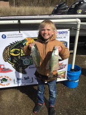Anderson Suitt, of Lawrence, holds up a pair of white crappie that he and his father, Joey, caught while fishing in the Kansas Crappie Trail season opener March 20 at Clinton Reservoir. Anderson caught the big fish for the team at 1.34 pounds, leading the pair to a 14th-place overall finish at 7.77 pounds. The team currently sits in second place in the KCT Rookie of the Year standings and first in the Adult/Youth Team Race.