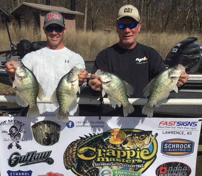 Topeka's Todd Morstorf, right, and Gardner's Tony Niemeyer hold up four of their winning crappie following the Kansas Crappie Trail season opener March 20 on Clinton Reservoir. The team weighed in 12.44 pounds of fish to just sneak past Lawrence father-and-son duo Mike and Eric Schrock (12.41) for the victory.