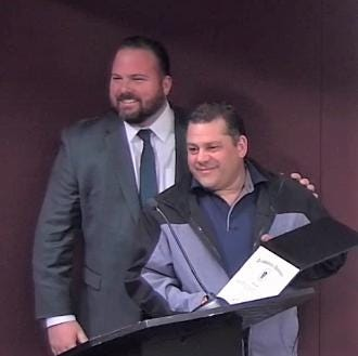 State Rep. David Muradian and Chris Etre after Etre was honored by the state House of Representatives last year.