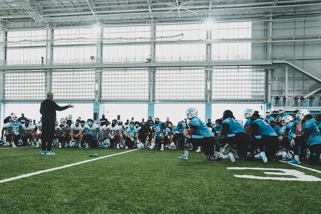 Head coach Mack Brown (left) addresses UNC's football team Thursday after its second spring practice.