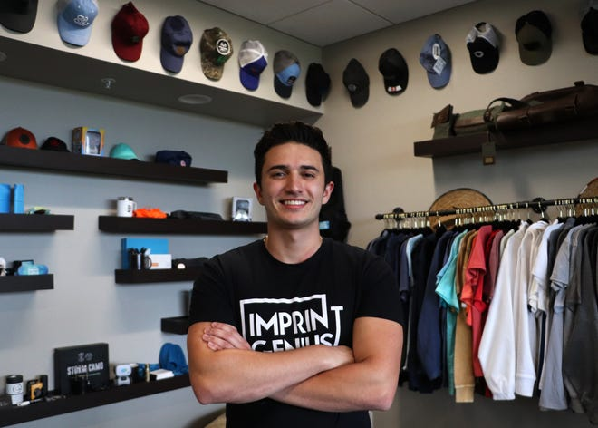 Isaac Hetzroni, Imprint Genius founder and CEO, poses for a photo in the startup's office at The Hub on Wednesday. Hetzroni was in the top five at the 2021 Global Student Entrepreneur Awards.