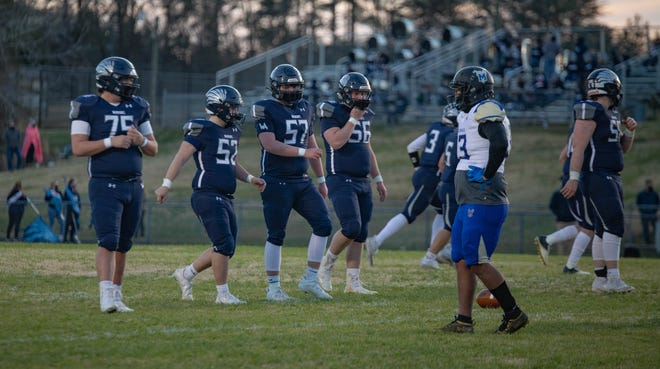 The Western Alamance offensive line walks up to the line of scrimmage.