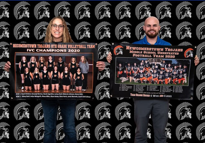 Charles Lenzo of Lenzo Studios has donated two banners and two framed/signed pictures representing fall season successes by teams at the Newcomerstown Middle School. Football coach Tyler Kiner and volleyball coach Sarah Johnson are pictured with banners for their respective sports. The eighth grade volleyball team won the Inter-Valley Conference tournament and the seventh and eighth grade football team went undefeated on the season. School officials thanked Lenzo and the coaches, parents and student athletes for their hard work and dedication.