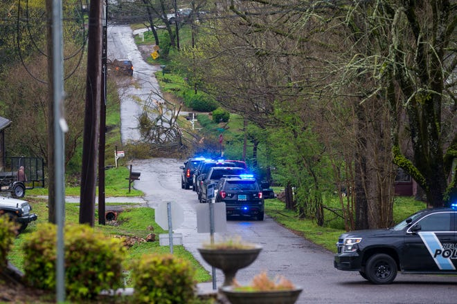 Police respond to a downed tree in Helena, Alabama, on Thursday, March 25, 2021. The National Weather Service issued multiple tornado warnings in Alabama and surrounding states.