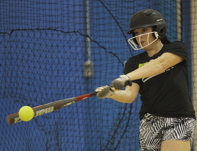 Grandview senior Maggie Lyon hits in the batting cage during practice March 19. The Bobcats have a young roster that includes seven freshmen and two sophomores.