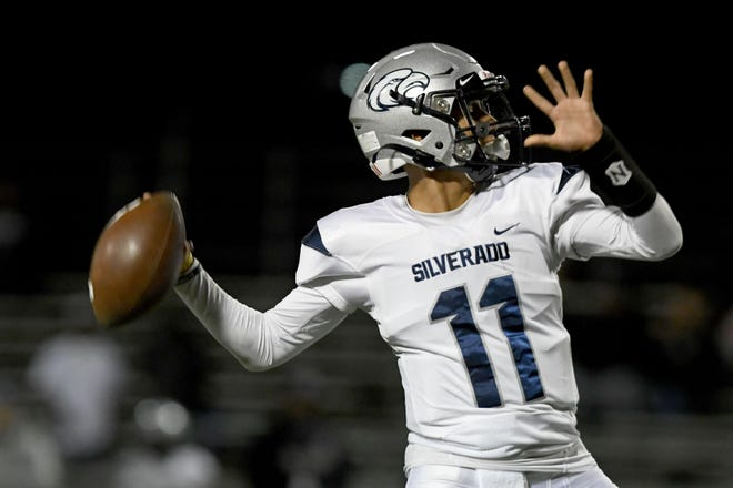 Silverado quarterback Jessie Murillo winds up to throw a pass against Victor Valley last season.