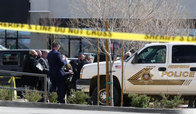 San Bernardino County Sheriff's authorities investigate the shooting of a deputy on Tuesday, March 23, 2021, in the Aldi shopping center on Bear Valley Road near the Mojave River in Hesperia.