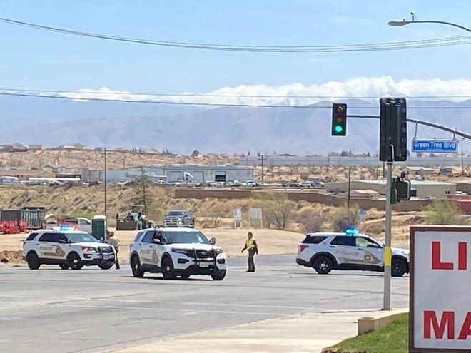 San Bernardino County Sheriff's deputies block off traffic at Green Tree Boulevard.