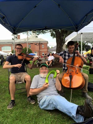 Billerica Farmers Market coordinator Jerry Johnson sat with the Double Drop Strings during a past market.