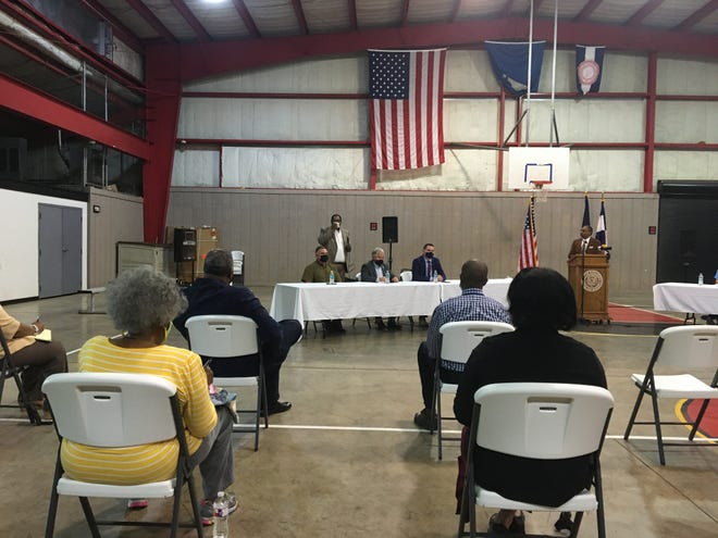 Rapides Parish Assistant District Attorney Clifton Spears (rear, standing) speaks Wednesday at a community forum on violent crime in Alexandria. Spears spoke about getting parents more involved.