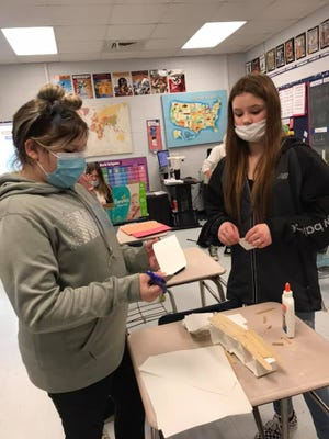 In this photo from March 19, Madison Middle School students in Mrs. West's sixth grade social studies class work on a STEM project based on Roman infrastructure.