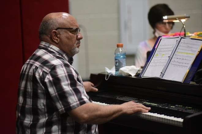 Mark Heydinger listens to his thespians sing as he accompanies with piano at Buckeye Central High School.